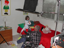 A father puts his daughter to bed in a scene for Good Samaritan Hospital.