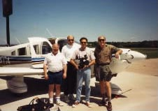 On location for Bethphage: Crew shot in front of plane.