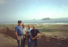 Crew overlooking the coast. L-R: Terry Field, Father Charles Coulter, Ron Chvala and Bill Chvala.
